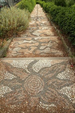 giardino: beautiful pebbled footpath in the Orti del Parnaso giardino dellOrticultura in Florence, Italy, Europe