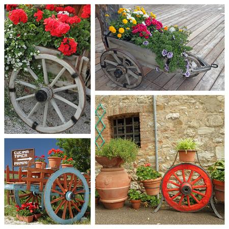 jardineras: plantas con flores en jardineras de madera con ruedas Foto de archivo