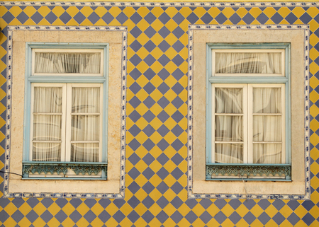 tiled wall: typical tiled exterior wall on portugese house Stock Photo