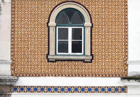 old building facade: detail of old building in Lisbon with characteristic ornamental ceramic facade Stock Photo