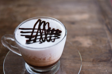 cappaccino: coffee on a wood table Stock Photo
