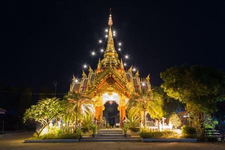 distric: Ornament: night landscape of bright buddhist shrine inChiangsaen distric Chiangrai province, Thailand