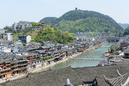 tentative: HUNAN, CHINA - April 14 : Old houses in Fenghuang county on Apr 14, 2015 in Hunan, China. The ancient town of Fenghuang was added to the UNESCO World Heritage Tentative List in the Cultural category.