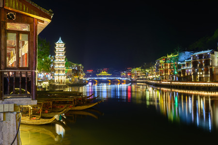 tentative: FENGHUANG,CHINA -April 14,2015 : (Phoenix) ancient town at night, Hunan province, China.This ancient town was added to the UNESCO World Heritage Tentative List in the Cultural category. Editorial