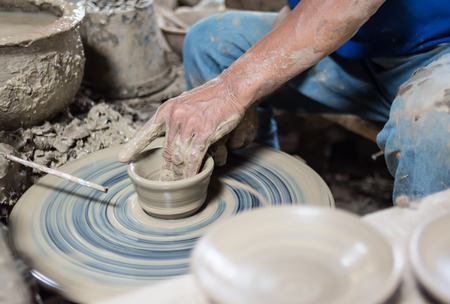 clay craft: Pottery craft wheel ceramic clay potter human hand