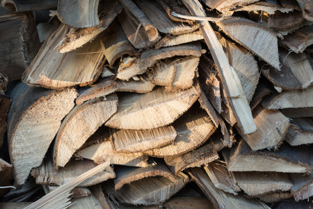 pile of logs: dry chopped firewood logs in a pile
