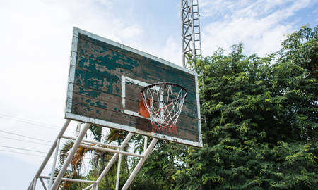 the height of a rim: old basketball hoop in public sport center Stock Photo