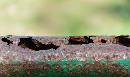 rust: patched oxidation rust iron green pole Stock Photo