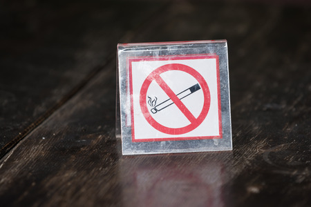 no smoking: No smoking sign on wooden table in the public cafe