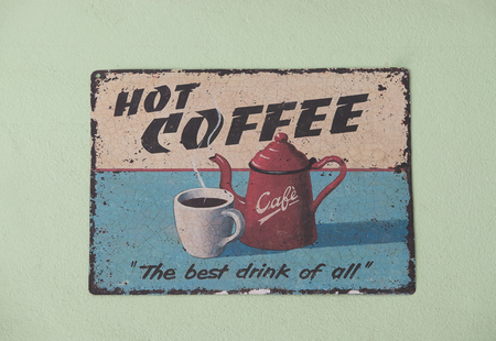 isolated sign: Retro Vintage Coffee Shop Sign on light green wall