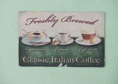 light green wall: Retro Vintage Coffee Shop Sign on light green wall