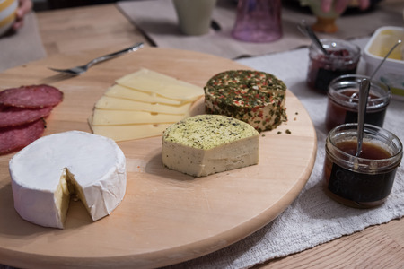 cheese platter: Cheese platter with different cheese with jam on table Stock Photo