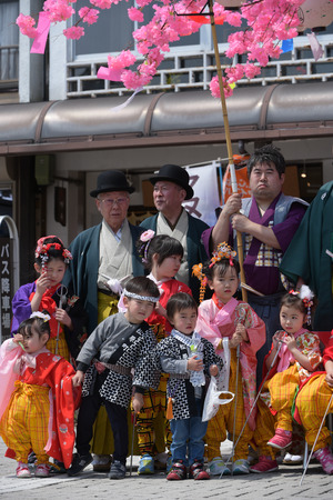 apri: NIKKO, JAPAN - APRIL 16: People of Nikko celebrate Yayoi festival on April 16, 2016 in Nikko where World-Heritage Shrines and Temples are located on  . It is a traditional event, which started in 767-770 and for 2016 year are cerebate 2 days on 16-17 Apri Editorial