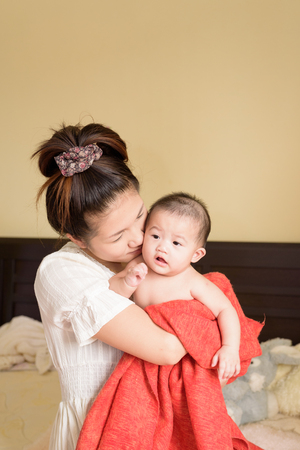 baby love: Asian young mom hold baby.