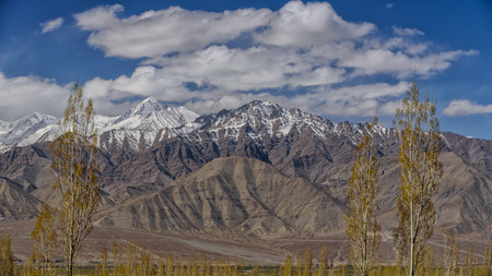 plains indian: mountain range in Leh with blue skies and cloud.