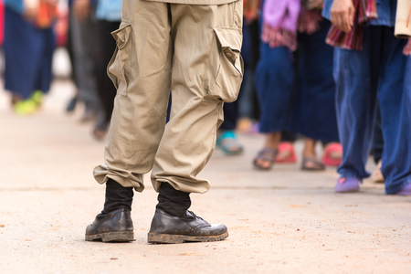 trouser legs: Leks of man in uniform suit in some festival in Thailand. Stock Photo