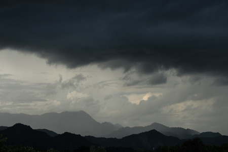 strom: Strom and big black cloud over mountain