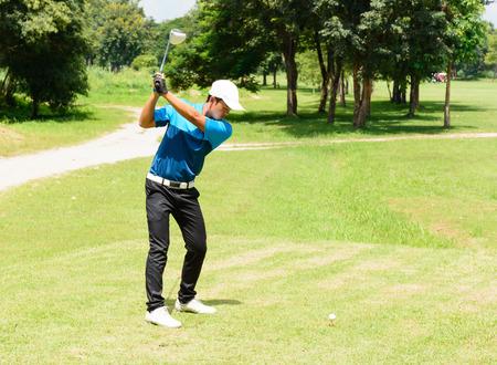 putt: Handsome asian golfers man putt golf on green. Stock Photo