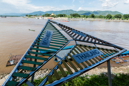 designates: CHIANG RAI, THAILAND - JUNE 21,2015 - Golden triangle in Thailand. The Golden Triangle designates the confluence of the Ruak River and the Mekong River,border of Thailand,laos and Burmar.