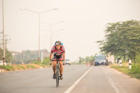 CHIANG RAI,THAILAND-APR 3,2016 : Sporter prepare to ride bicycle in Golden Triangle Triathlon on April 3 ,2016 in Chiang sean district Chiang rai,Thailand. Editorial