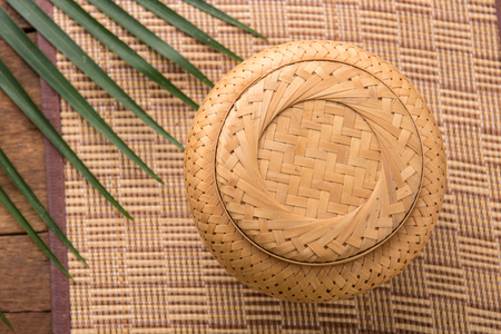 induce: Sticky rice box,be the light while,member northeast in which,the aborigine in northeastern area of Thailand adds sticky rice steams cooked for already induce to eat. Stock Photo