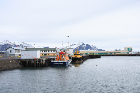Transportation ship park in Hornafjordur port, a blooming community in the realm of the greatest glacier in southeast Iceland. Stok Fotoğraf