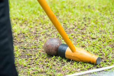 Woodball, sport equipment, Sports Woodball a way to play a sport like golf Woodball is played with a mallet whose head looks remarkably like a wooden beer bottle. Stock Photo