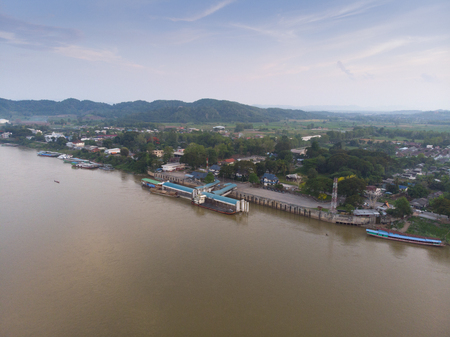 top view of drone camera of Laos transportation boats parking at golden triangle port of Chiang saen,Chiang rai,Thailand