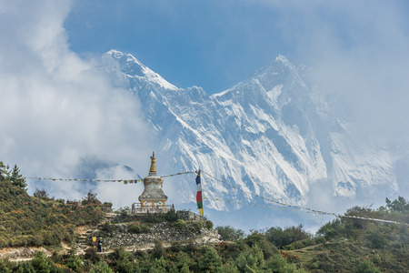 View of Mount Everest and Nuptse with buddhist prayer flags from kala patthar in Sagarmatha National Park in the Nepal Himalaya Stock Photo