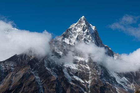 Grand snowy peak of a mountain in the Everest region. Lobuche, Nepal