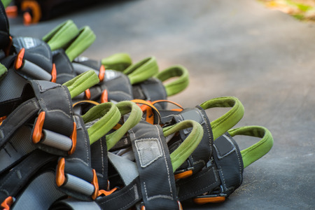 Safety belts with carbines and helmet. obstacle course equipment for outdoor activity and sport. Standard-Bild