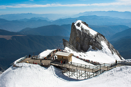 Kunming,China - 2019 April 24 : On the top of Dragon snow mountain in Lijiang Kunming China which covered by snow and crowed of tourist.