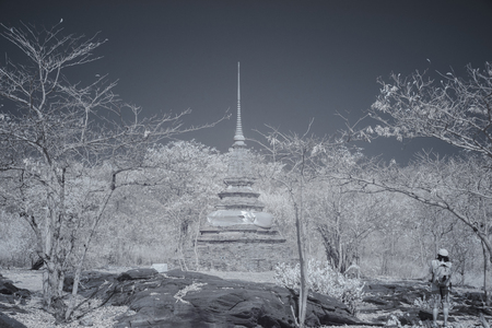 Man take photo of old temple in public park with infrared photo technology.