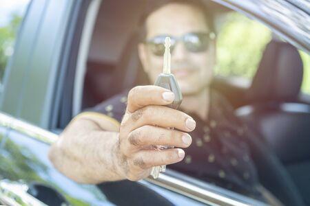 pakistani muslim Man sit in car and showing car key