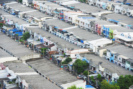Aerial view of Bangkok City figuring poor houses in slums like district, heavily population and crowded, congested house in big city.