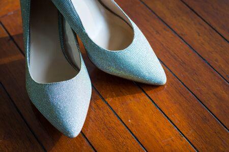 fashion bridal wedding high heeled shoes decorated on glamour modern accessory background.