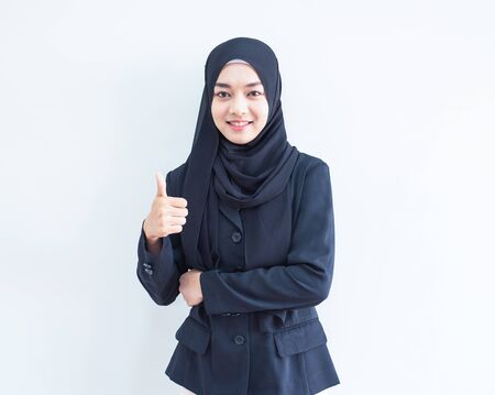 Beautiful female Muslim model in modern kurung and hijab, a modern lifestyle apparel for Muslim women isolated on white background. Beauty and hijab fashion concept. Half length portrait