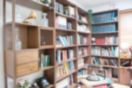 Abstract blur defocused background of books on bookshelf in library, Education and scholarship opportunity.World book day concept.
