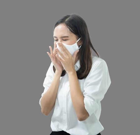 Protection against contagious disease, coronavirus.Asian woman wear mask and couch prevent infection,airborne illness as flu and sneezing , Covid-19 indoor studio shot isolated on white background.