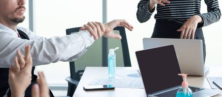 Hand of conference business coworker in workplace rub hand after get sanitizer alcohol gel spray protect from coronavirus or covid-19 virus world pandemic,health care and medicine concept.
