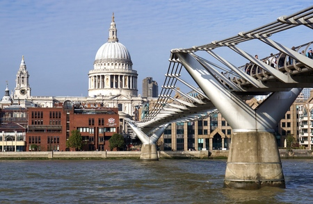 st pauls cathedral: LONDON, UK - OCTOBER 11 2015: Pedestrians cross the Millennium Bridge towards St Pauls Cathedral and the independent City of London School. Editorial
