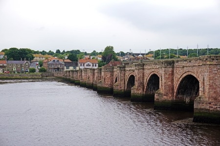 17th: Old 17th century stone bridge over the River Tweed in the town of Berwick-upon-Tweed in the north east of England