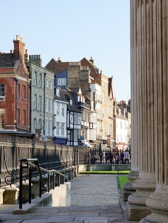 senate: CAMBRIDGE, UK - SEPTEMBER 6 2015: Shops and historic buildings along Kings Parade, Cambridge, England, as viewed from the Senate House. Editorial