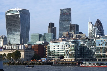 30 st mary axe: LONDON, UK - OCTOBER 11 2015: Skyscrapers, including the recent 20 Fenchurch Street Walkie-Talkie building and 30 St Mary Axe the Gherkin, rise above other towers and office buildings in the City of London.