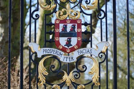 cambridge: CAMBRIDGE, UK - FEBRUARY 23 2016: Three black cockerels decorate the crest of Jesus College, Cambridge. Editorial