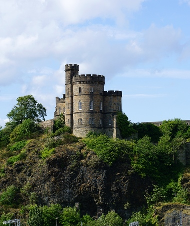 gaol: EDINBURGH, UK - JULY 18 2015: The historic Governors House, a remnant of the early 19th-century former Calton Gaol designed by Archibald Elliot, sits atop the ridge of Calton Hill in Edinburgh, Scotland. Editorial