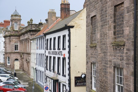 BERWICK-UPON-TWEED, UK - JULY 20 2015: Parked cars line a street of historic buildings in the centre of the northeast England town of Berwick-upon-Tweed, Northumberland. Editorial