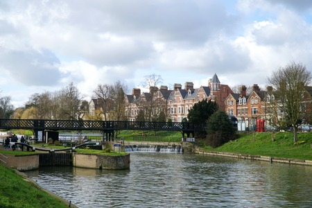 A view of Chesterton Road and the lock, weir and pedestrian footbridge near Jesus Green in Cambridge, UK.