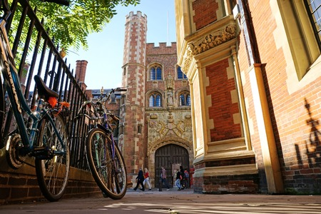 CAMBRIDGE, UK - SEPTEMBER 27 2015: Pedestrians pass the entrance gate of St John's College, Cambridge, England.