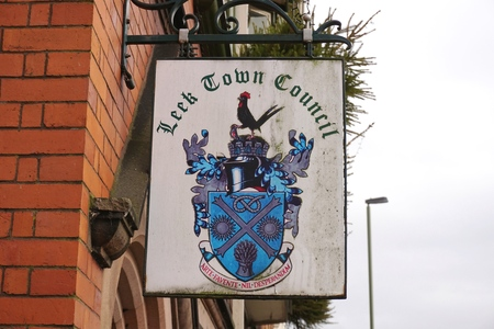 local government: LEEK, UK - DECEMBER 31 2015: A sign for Leek Town Council hangs outside local government offices in the small market town of Leek, in the Staffordshire Moorlands, England.